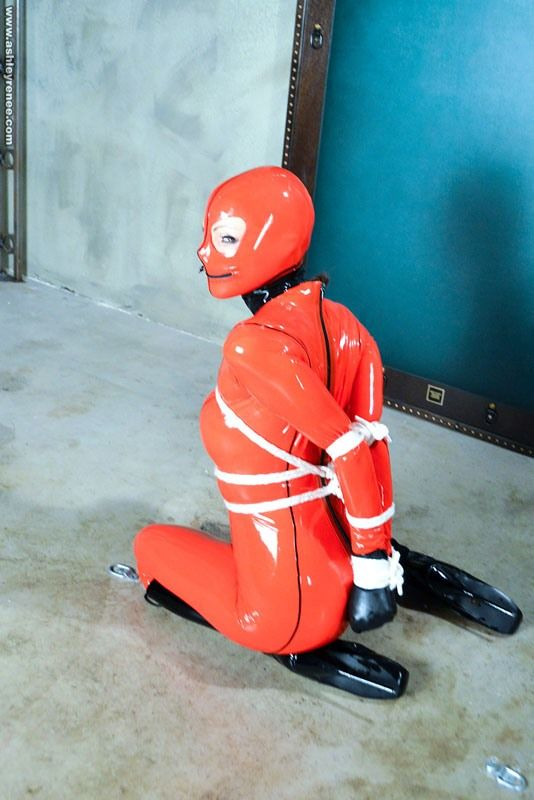 Ashley Renee in red latex catsuit & ballet shoes tied up on floo